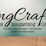 quill on desk and words 'SongCraft 7 week songwriting circle'